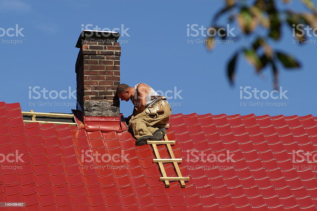 man on the roof stock photo