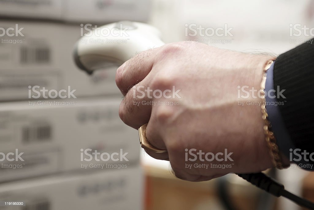 Man on the stock works with a barcode reader. royalty-free stock photo