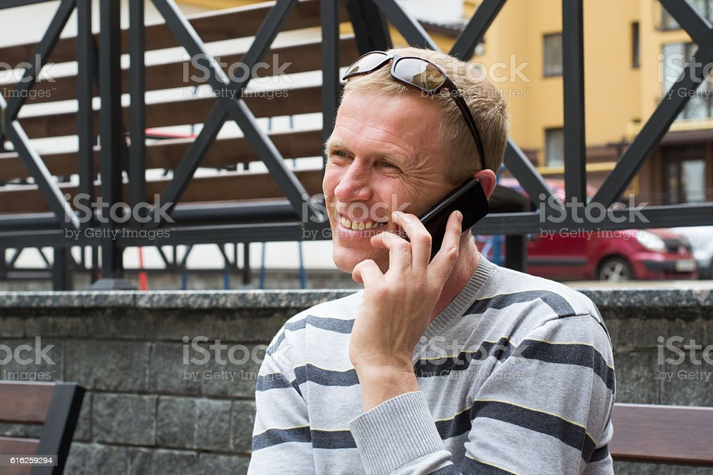 man on the street with a mobile phone stock photo
