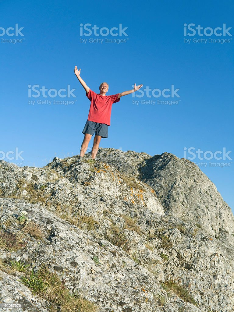 Man on the top of mountain royalty-free stock photo