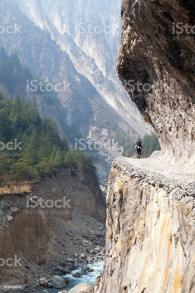 man on the way, rock road in round Annapurna circuit stock photo