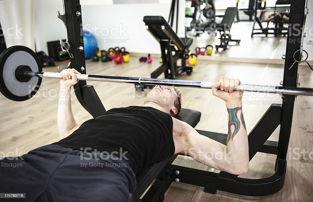 Man on the weight bench royalty-free stock photo