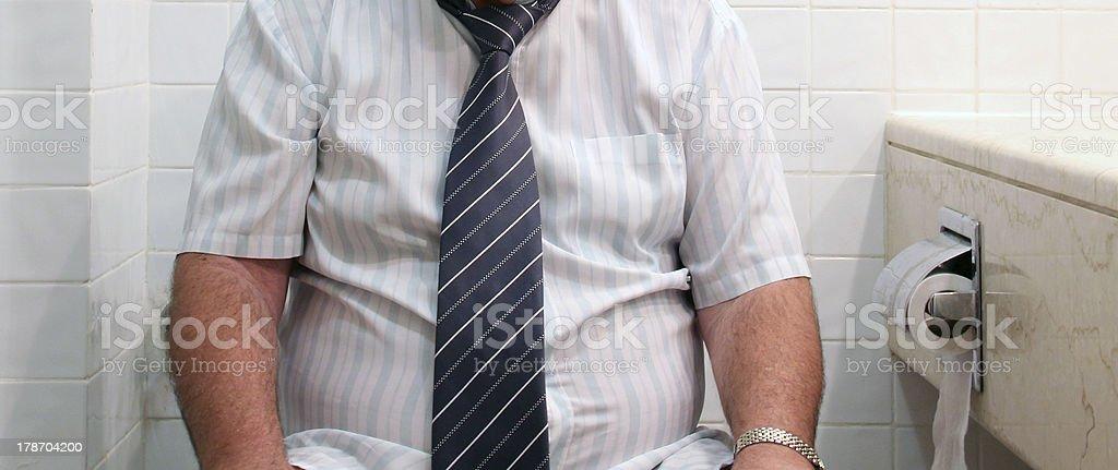 Man on toilet seat stock photo
