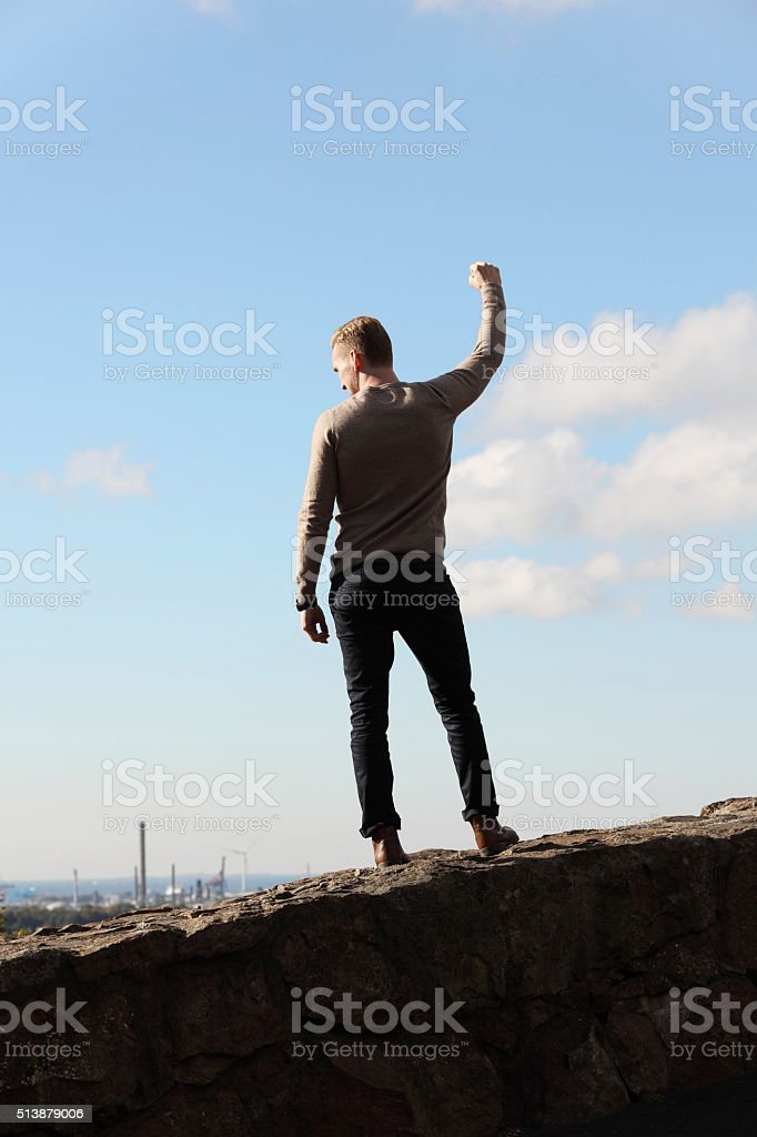 Man on top of mountain cityscape stock photo