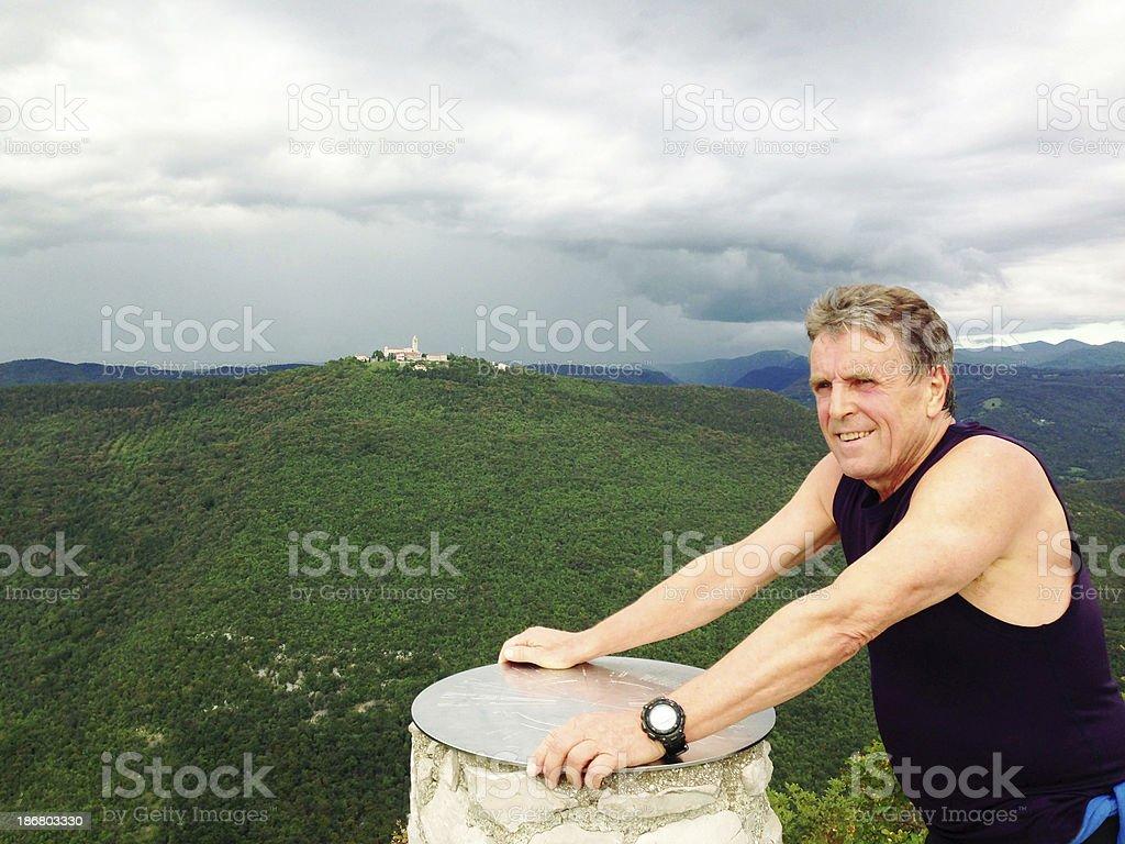 Man on Top of Mountain Sabotin Slovenia royalty-free stock photo