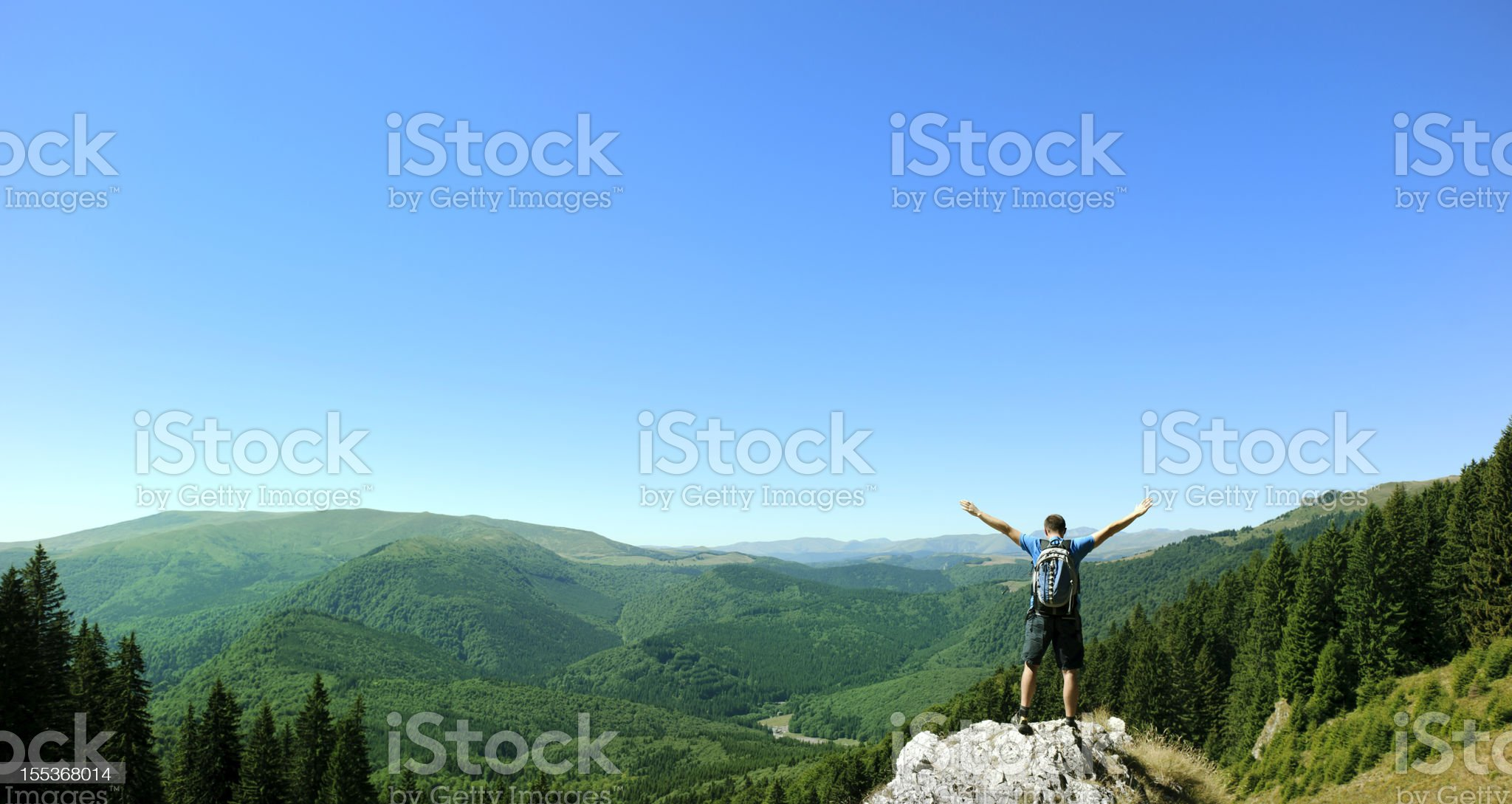 man on top of mountains royalty-free stock photo