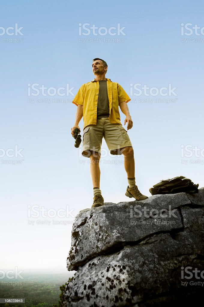 Man on top of Rocky Mountain Peak royalty-free stock photo