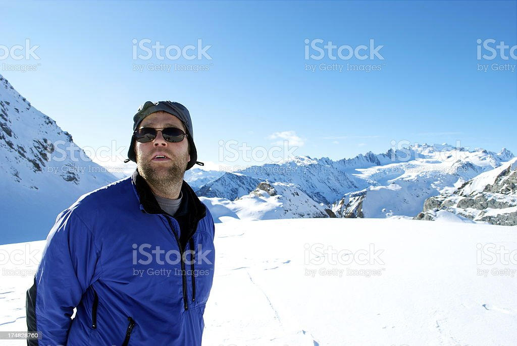 Man on top of the Mt Cook Ranges, New Zealand royalty-free stock photo