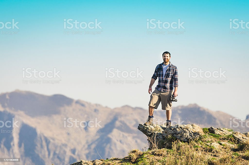 Man on top of the peak royalty-free stock photo