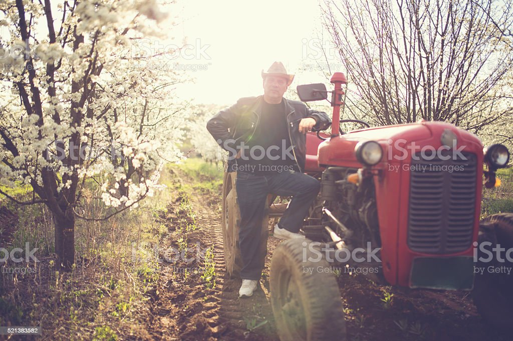 Man on tractor stock photo