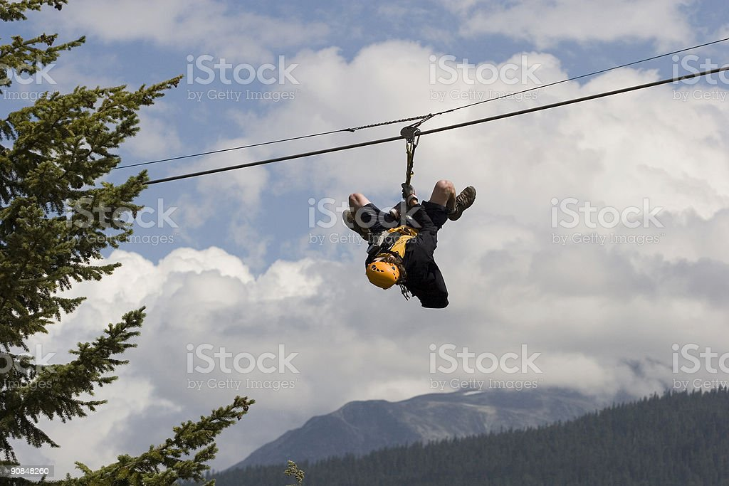 Man on trapeze stock photo