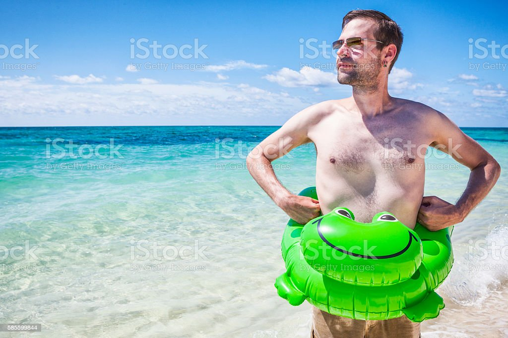 Man on vacation at the beach in the Bahamas stock photo