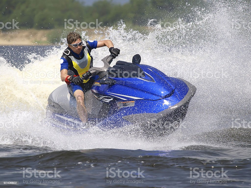Man on Wave Runner turns fast stock photo