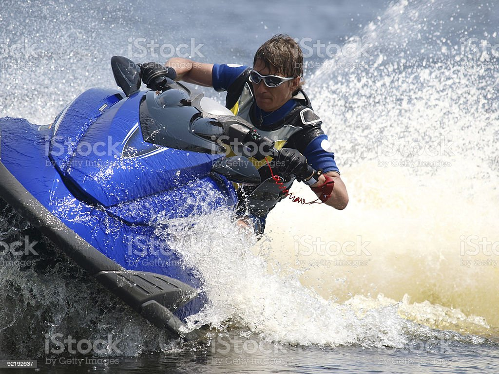 Man on WaveRunner - extreme sport stock photo