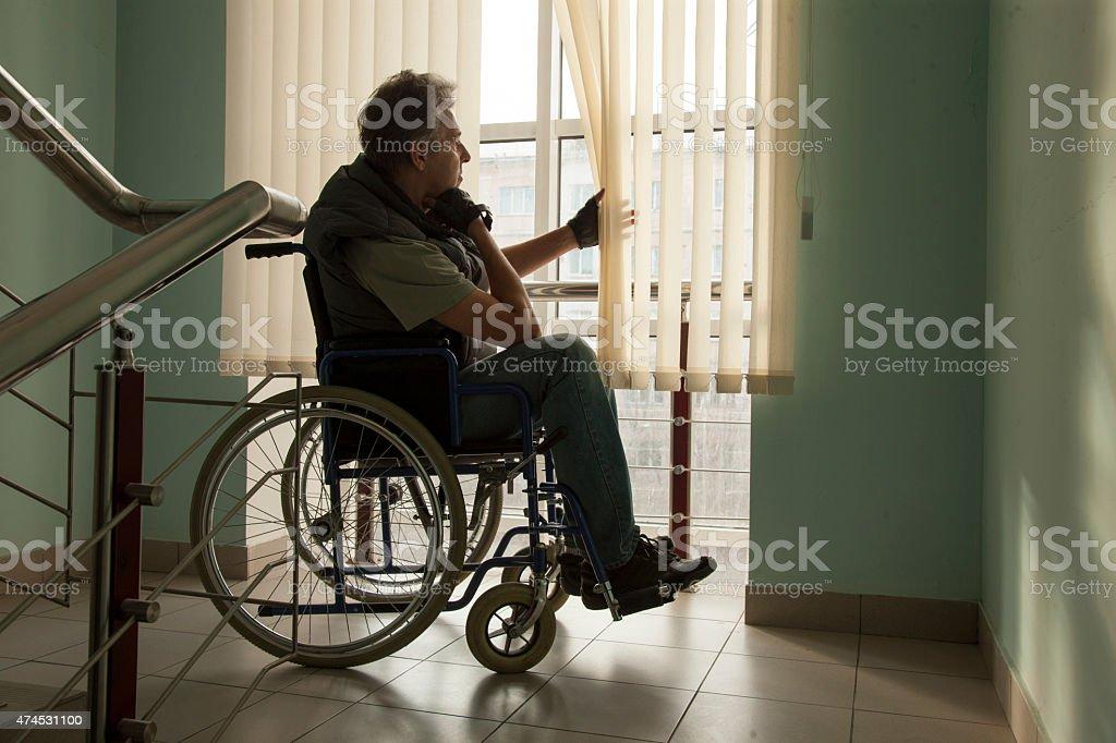 Man on wheelchair stock photo