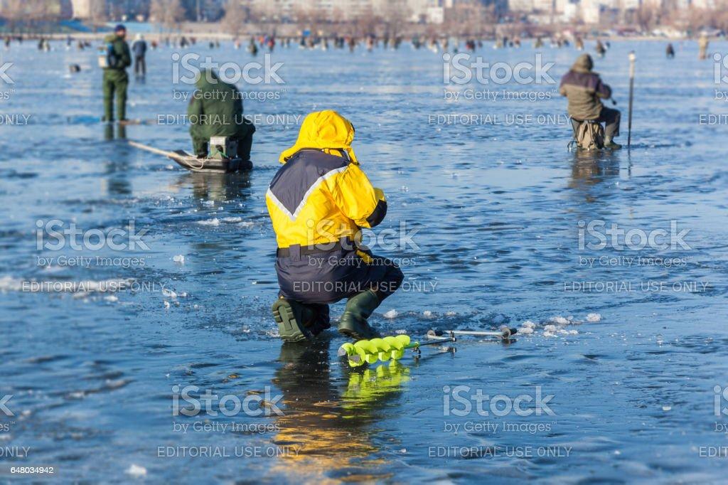 man on winter fishing stock photo