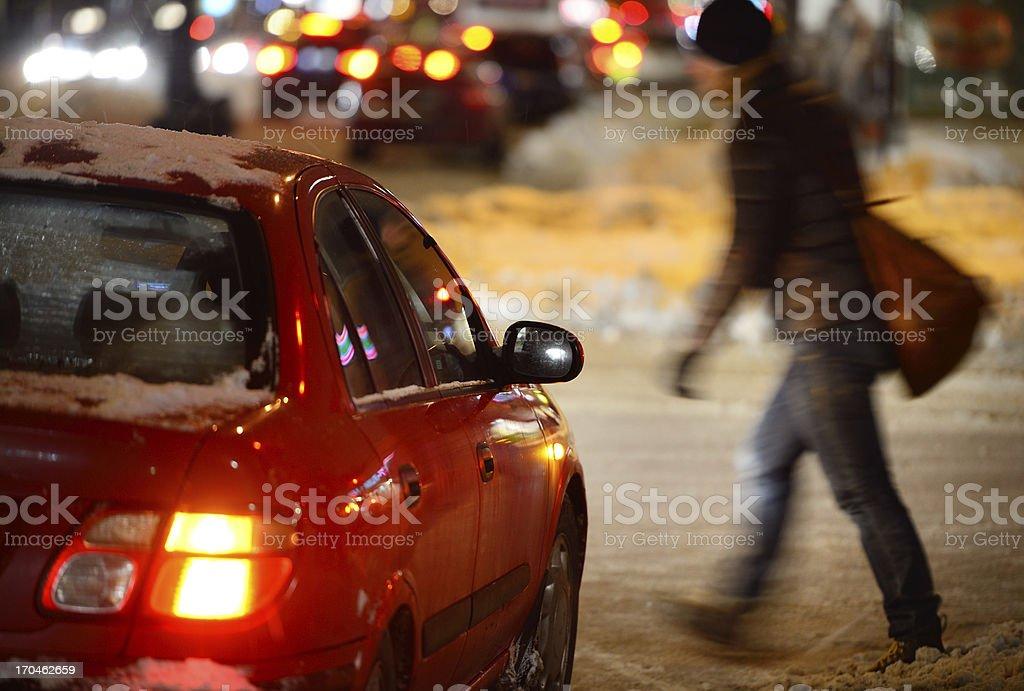 Man on winter zebra crossing stock photo