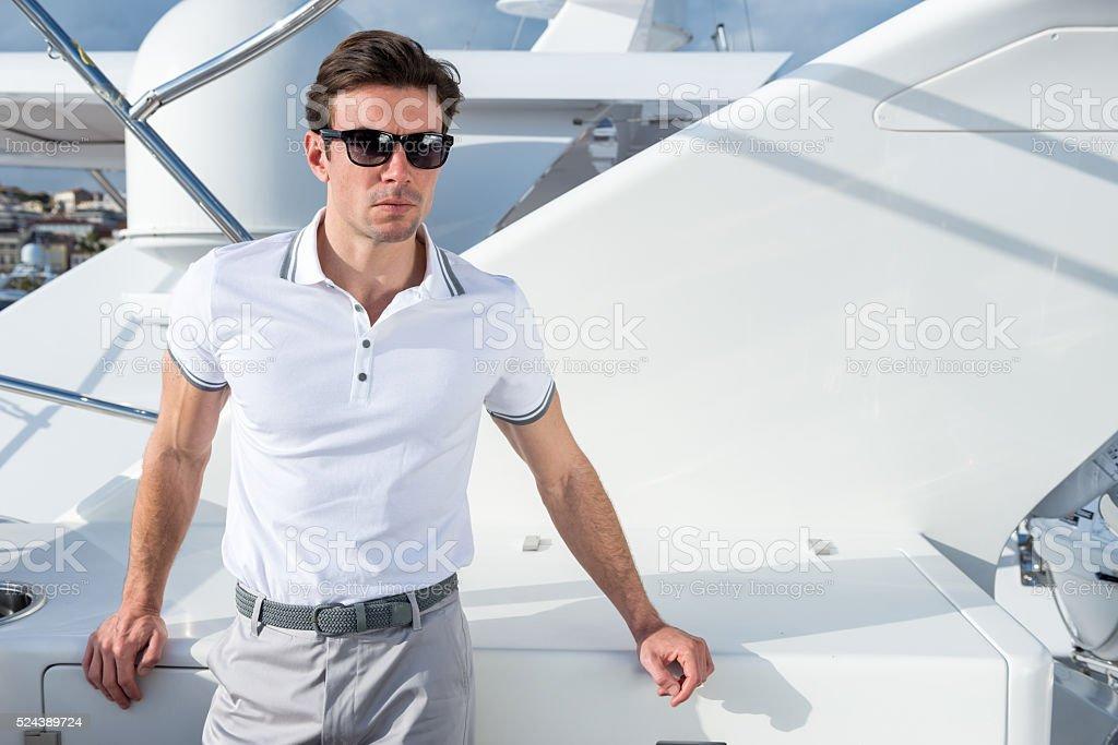 Man on yacht stock photo