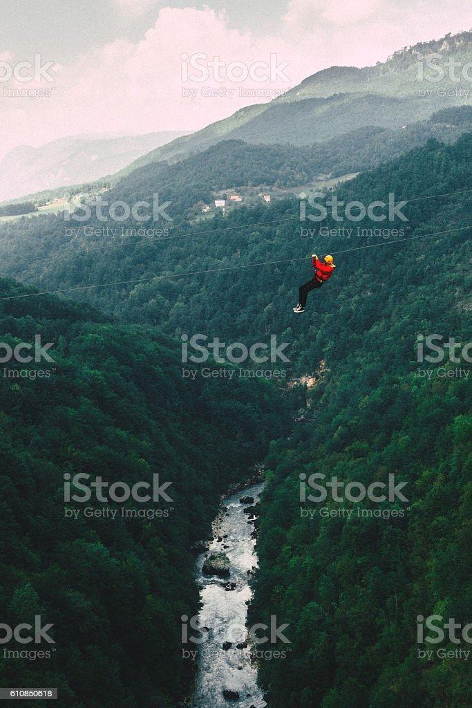 Man on zip line under the Tara river stock photo