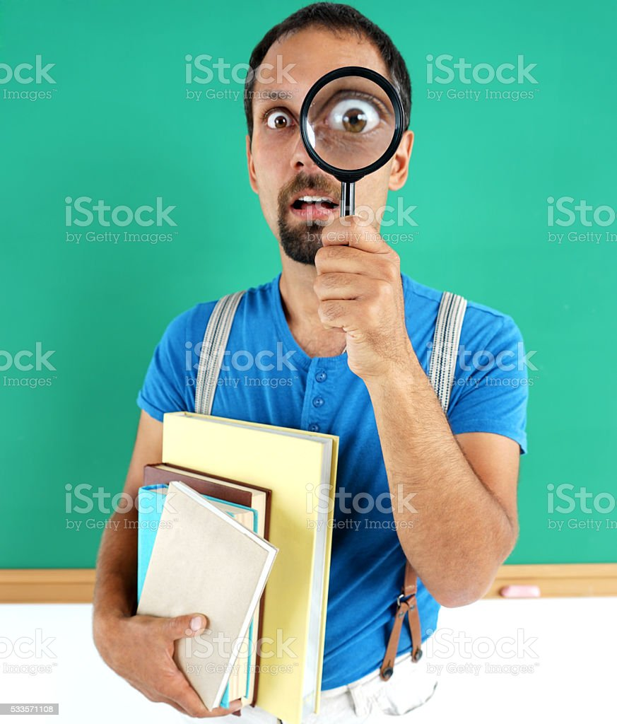 Man open-eyed with magnifier stock photo