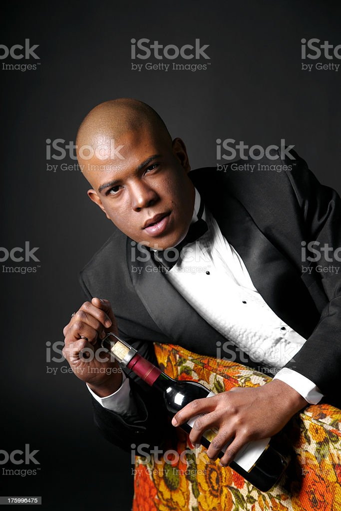 Man opening a bottle of wine royalty-free stock photo