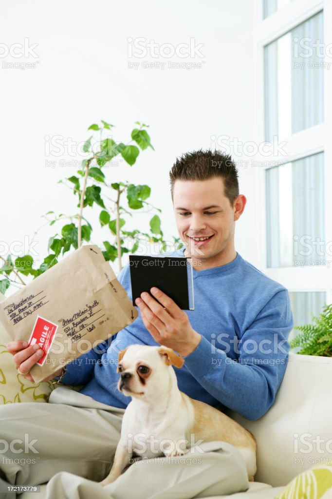 Man opening a package royalty-free stock photo