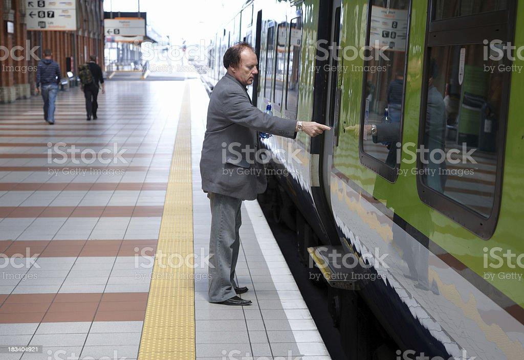 Man opening door to train royalty-free stock photo