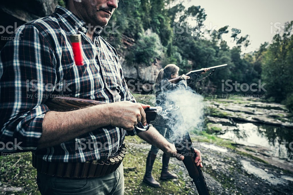 Man opening gun stock photo