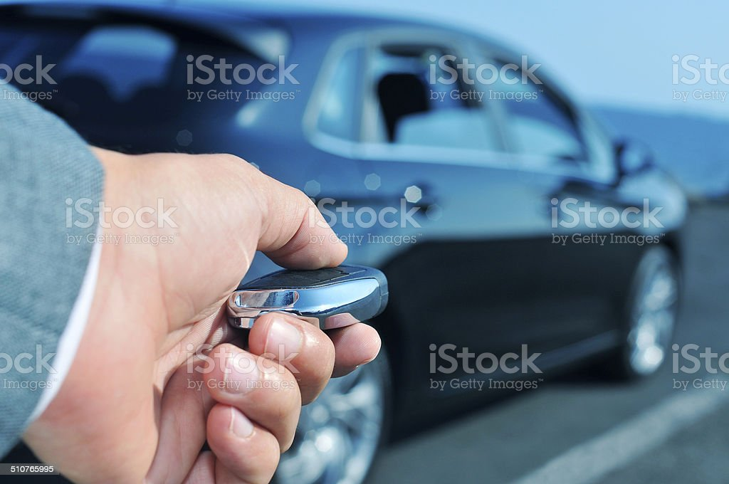 man  opening his car with the control remote key stock photo