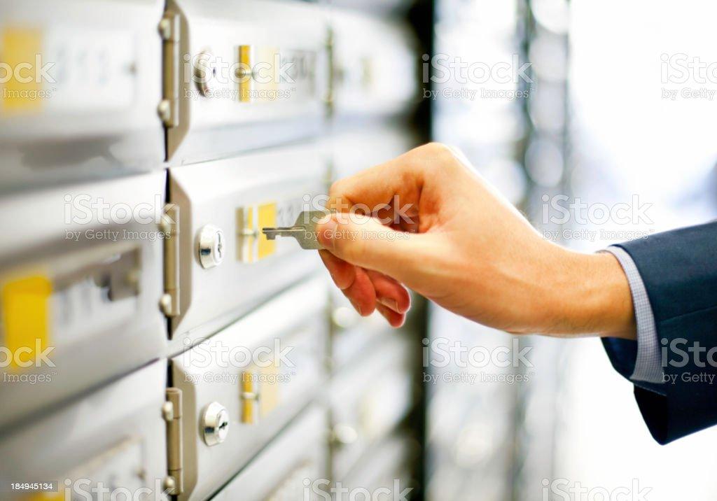Man opening mailbox stock photo