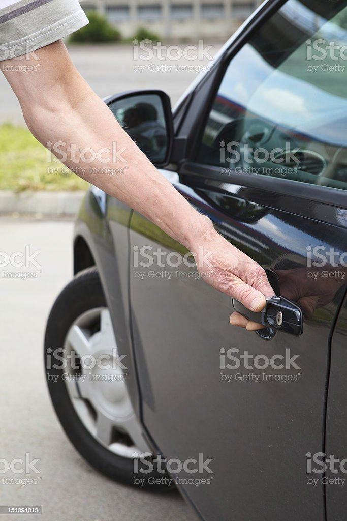 Man opening vehicle door in own black car royalty-free stock photo