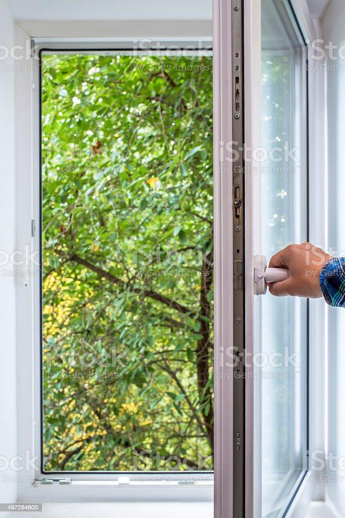 man opens pvc window stock photo
