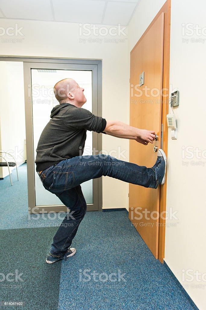 man opens the door force stock photo