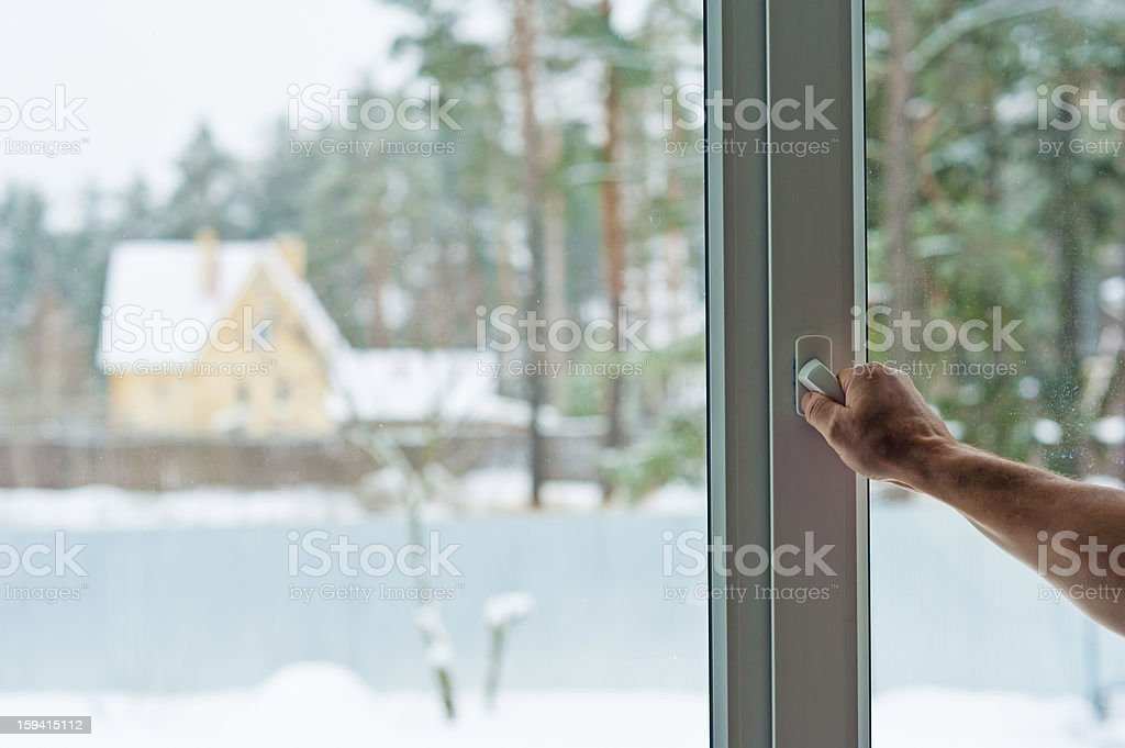 man opens the window royalty-free stock photo