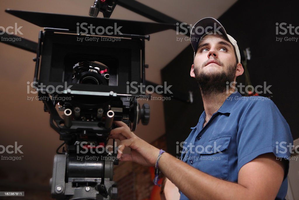 A man operating a high-definition camera stock photo