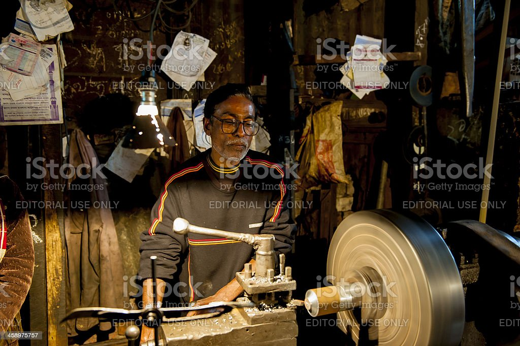 Man operating lathe in workshop, Bangladesh stock photo