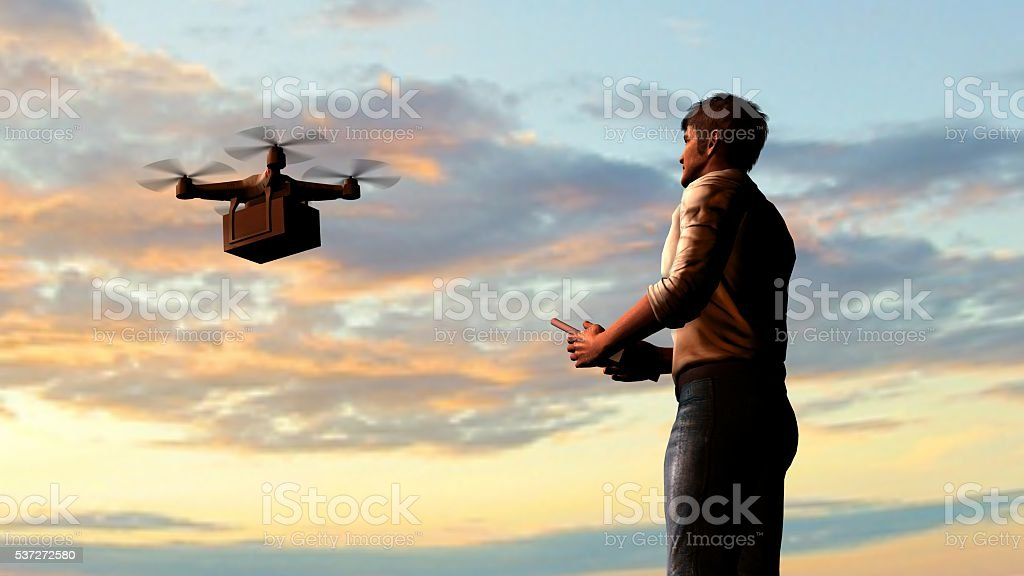 man operating of flying drone quadrocopter with package stock photo