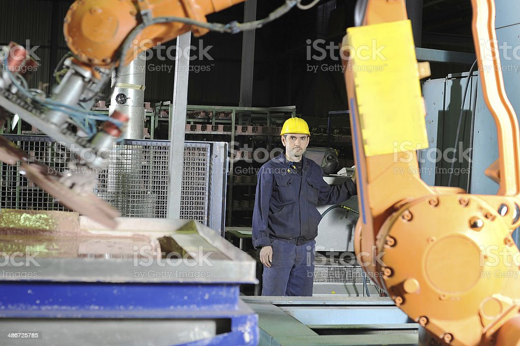 Man operating robot arm stock photo