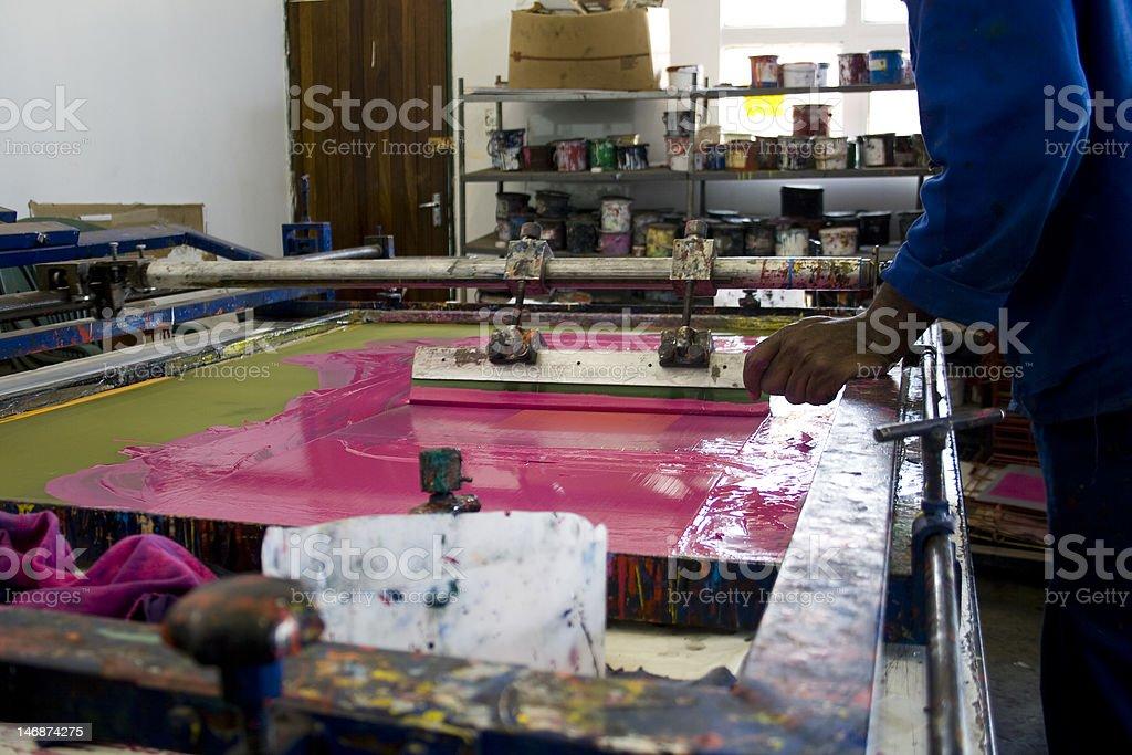 Man operating silk screen stock photo