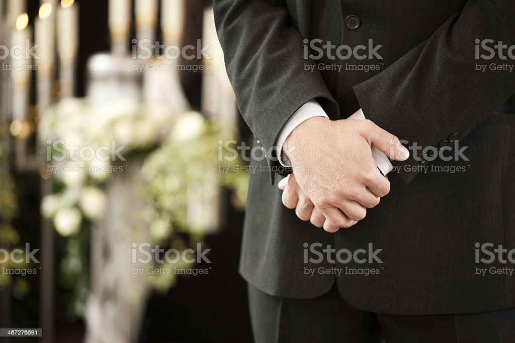 man or mortician at funeral mourning stock photo