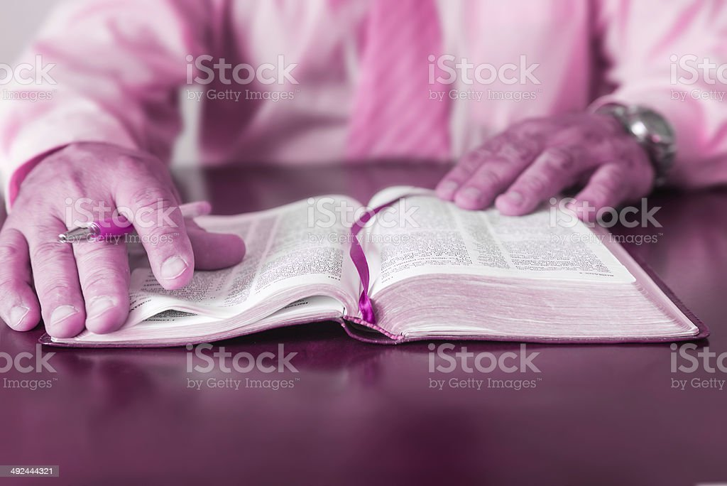 Man or Pastor studying teaching the Bible royalty-free stock photo