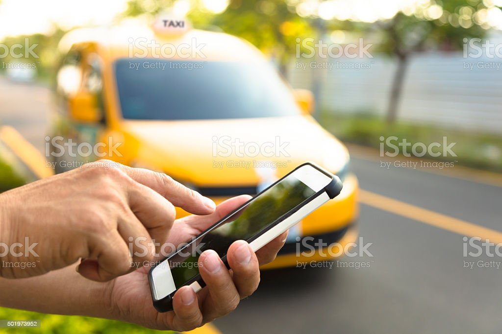 Man orders a taxi from his cell phone stock photo