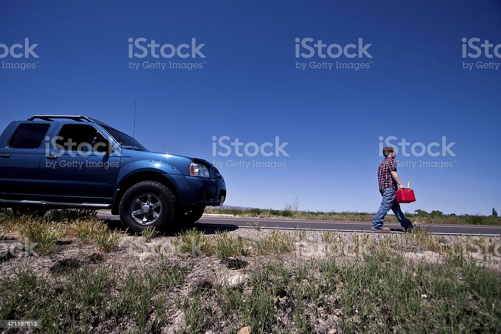 Man Out of Gas Walking with Can stock photo