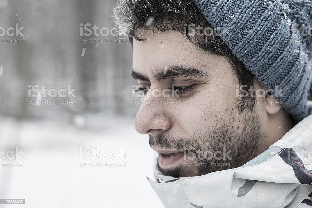 Man outdoor portrait under snowfall royalty-free stock photo