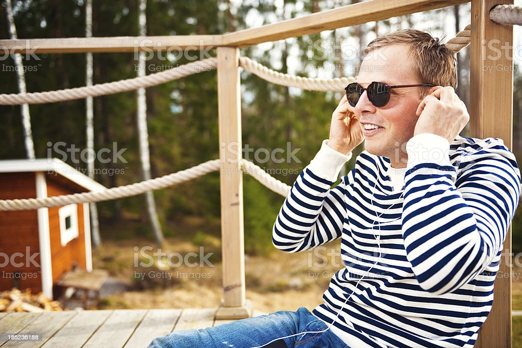 Man outdoors listening to music royalty-free stock photo