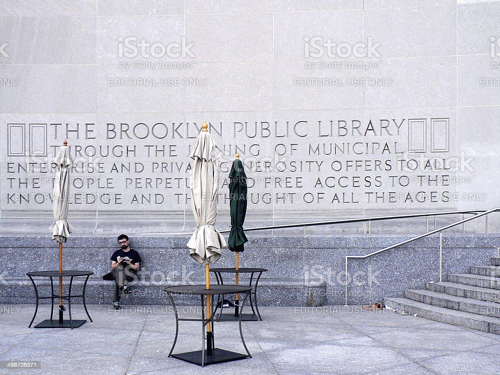 Man outside Brooklyn Public Library stock photo