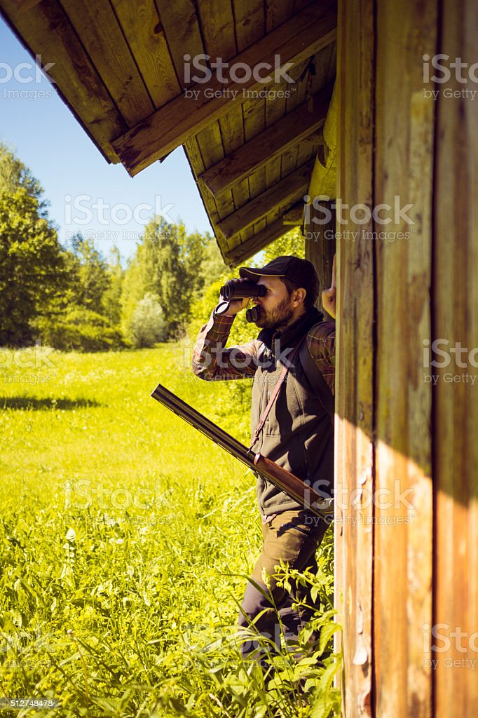 Man Outside His Wooden House Ready To Hunt stock photo