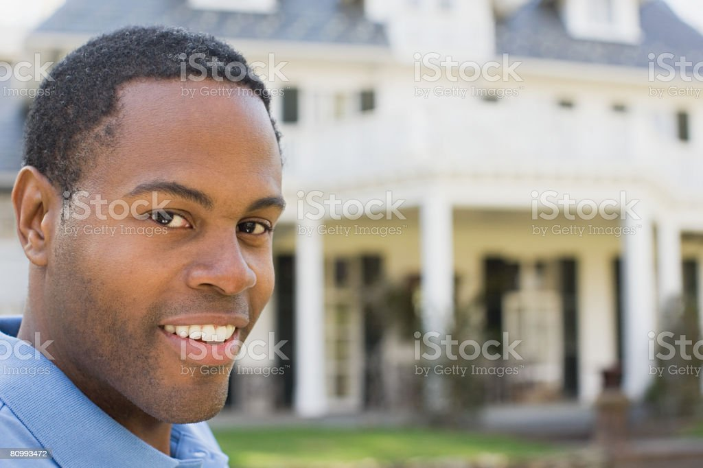 Man outside house stock photo