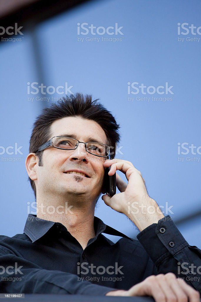 Man outside with cell phone royalty-free stock photo