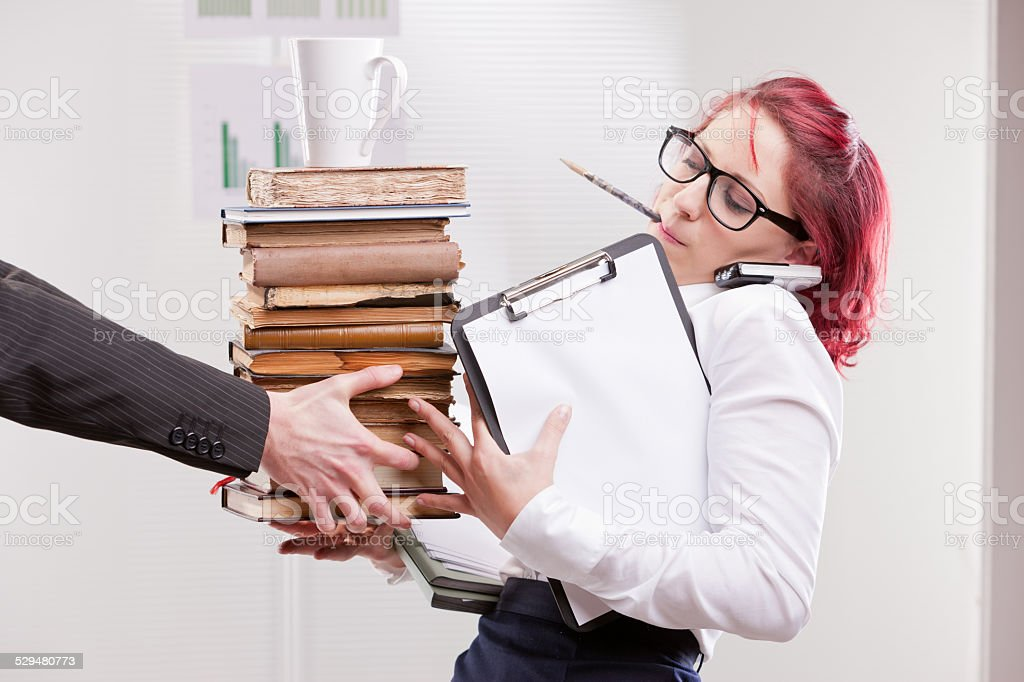 man overloading colleague woman with work stock photo